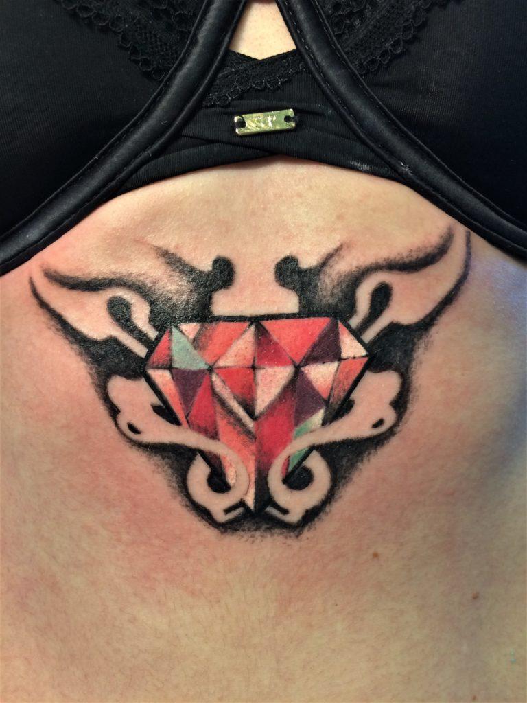 gem underboob tattoo