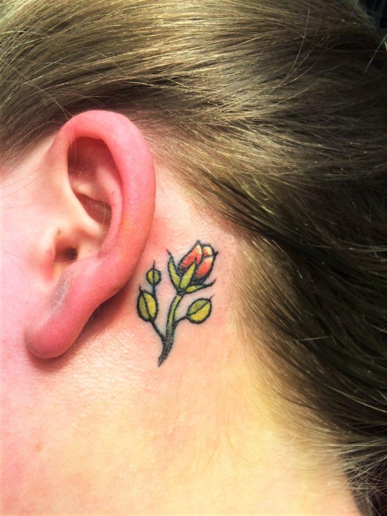 ear tattoo rose