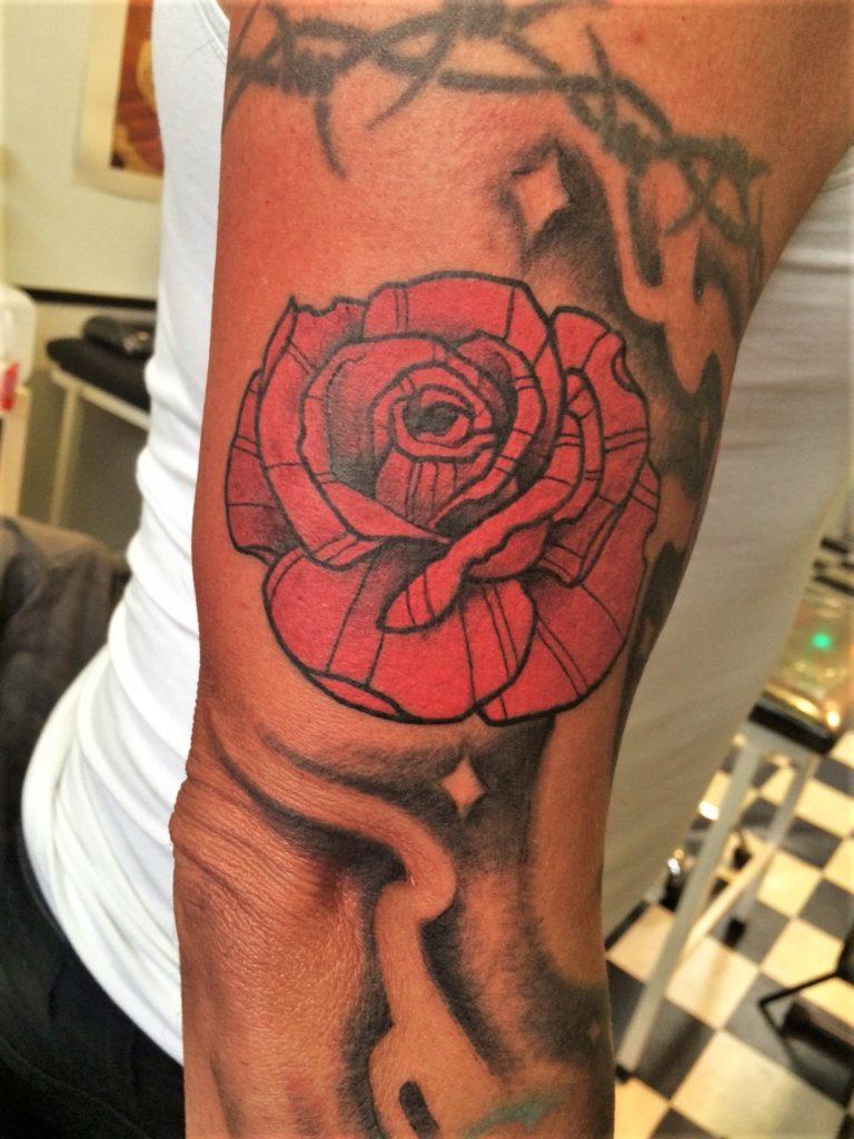 rose tattoo arm sleeve