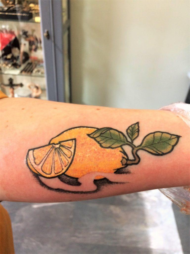 lemon arm tattoo from Inkfish